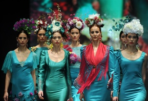 Models present creations by new designer Cristina Granero during the SIMOF (International Flamenco Fashion Show) in Sevilla, on February 5, 2016. AFP PHOTO/ CRISTINA QUICLER / AFP / CRISTINA QUICLER (Photo credit should read CRISTINA QUICLER/AFP/Getty Images)