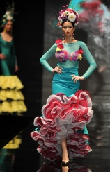 A model presents a creation by new designer Cristina Granero during the SIMOF (International Flamenco Fashion Show) in Sevilla, on February 5, 2016. AFP PHOTO/ CRISTINA QUICLER / AFP / CRISTINA QUICLER (Photo credit should read CRISTINA QUICLER/AFP/Getty Images)